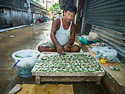 14 AUGUST 2015 - BANGKOK, THAILAND: A Burmese man sells betel in Saphan Pla fish market in Bangkok. The workers in the market are Thai and Burmese but only the Burmese still chew betel. Chewing betel was banned by Thai Prime Minister Field Marshal Plaek Pibulsonggram in 1942 and only very old Thais, mostly women, still chew betel in Thailand. Saphan Pla fish market is the wholesale fish market that serves Bangkok. Most of the fish sold in Saphan Pla is farmed raised fresh water fish. The market is open 24 hours but it's busiest in the middle of the night and then again from about 7.30 until 11 in the morning.        PHOTO BY JACK KURTZ