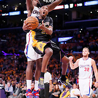 31 October 2014: Los Angeles Lakers guard Kobe Bryant (24) goes for the reverse layup past Los Angeles Clippers center DeAndre Jordan (6) during the Los Angeles Clippers 118-111 victory over the Los Angeles Lakers, at the Staples Center, Los Angeles, California, USA.