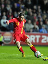 Gareth Bale (Tottenham Hotspur) of Wales  breaks free of the defence to score Wales opening goal of the game - Photo mandatory by-line: Joe Meredith/JMP - Tel: Mobile: 07966 386802 06/02/2013 - SPORT - FOOTBALL - Liberty Stadium - Swansea  -  Wales V Austria - International Friendly