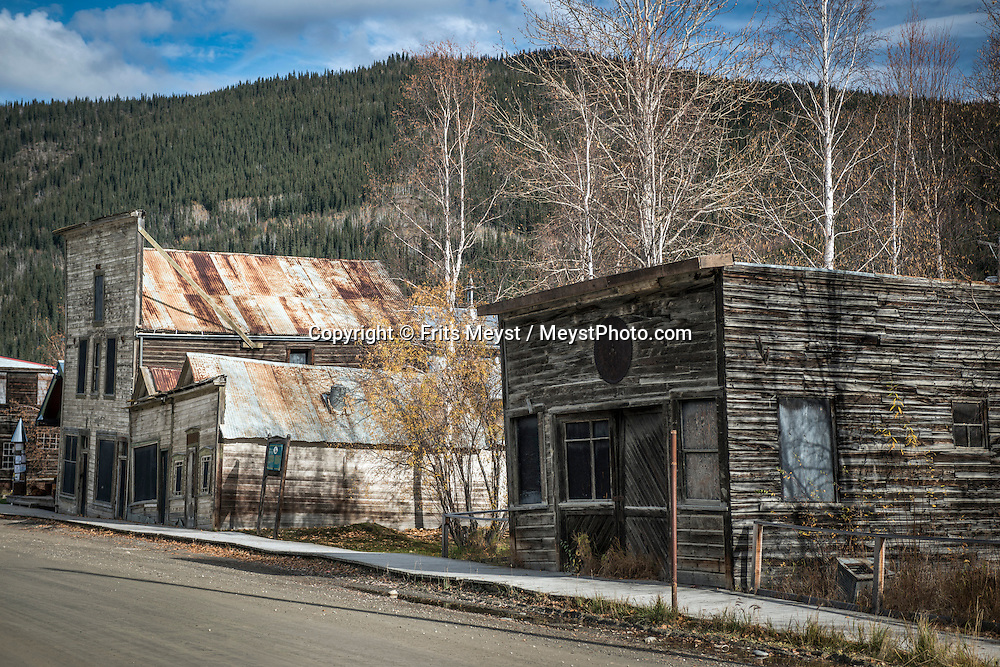 Yukon Territory, Canada, September 2014. historical buildings in Dawson City. Gold Rust! Remnants of the Klondyke Gold Rush Left in the Yukon Landscape. The Yukon Territory received world fame during the Klondike Gold Rush in 1898.  Photo by Frits Meyst / MeystPhoto.com