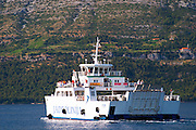 The car and passenger ferry between Orebic and Korcula Orebic town, holiday resort on the south coast of the Peljesac peninsula. Orebic town. Peljesac peninsula. Dalmatian Coast, Croatia, Europe.