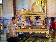 "04 MARCH 2015 - BANGKOK, THAILAND: A man prays in the ""wiharn,"" or prayer hall at Wat Benchamabophit on Makha Bucha Day. Makha Bucha Day is an important Buddhist holy day and public holiday in Thailand, Cambodia, Laos, and Myanmar. Many people go to temples to perform merit-making activities on Makha Bucha Day. Wat Benchamabophit is one of the most popular Buddhist temples in Bangkok.    PHOTO BY JACK KURTZ"