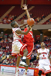 """11 November 2007: Keith """"Boo"""" Richardson goes hard to the bucket against Jason Black. Illinois State Redbirds defeated the Missouri - St. Louis Tritons 70-37 in an early season game on Doug Collins Court in Redbird Arena on the campus of Illinois State University in Normal Illinois."""