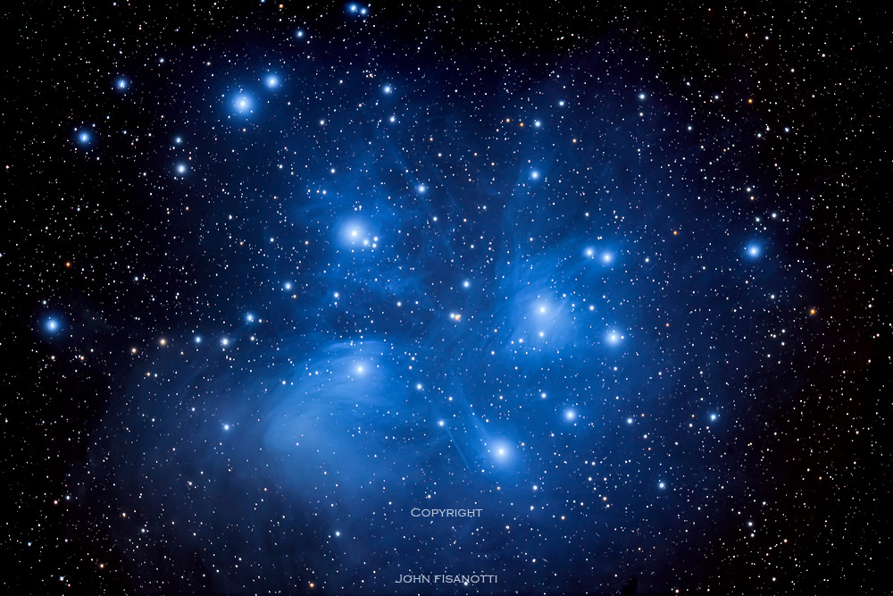 The Pleiades star cluster in Taurus, is visible to the naked eye as a tiny dipper shaped asterism