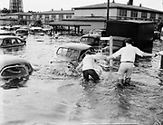 """Y-480530-05.  """"Boys in Vanport, Ore., struggle to higher ground after abandoning their car as Columbia River flood waters inundate the community of 18,700."""" (excerpt of  caption on Milwaukee (Wisconsin) Journal, May 31, 1948.) May 30, 1948."""