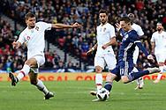 Scotland midfielder Callum McGregor (11) (Celtic) and Portugal defender Ruben Dias (6) (Benfica)  during the Friendly international match between Scotland and Portugal at Hampden Park, Glasgow, United Kingdom on 14 October 2018.