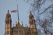 "London, UK. Monday 8th April 2013. Union flag at half mast above the Houses of Parliament. In honour of Baroness Margaret Thatcher following the announcement of her death. Maggie Thatcher (87), aka the ""Iron Lady"" dominated British politics for 20 years, died peacefully on 8/4/13 following a stroke."