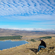 Hiker at the summit of Mt John, Tekapo