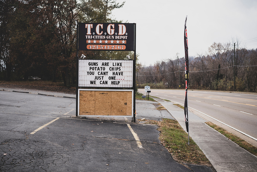 Elizabethton, TN - November 24, 2016: The marquee at Tri-Cities Gun Depot in Elizabethton, Tennessee, reads: GUNS ARE LIKE POTATO CHIPS YOU CANT HAVE JUST ONE…WE CAN HELP.