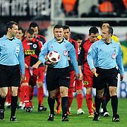 Referee's Ilker MERAL (C) during their Turkish superleague soccer match Besiktas between Genclerbirligi at BJK Inonu Stadium in Istanbul Turkey on Friday, 15 April 2011. Photo by TURKPIX