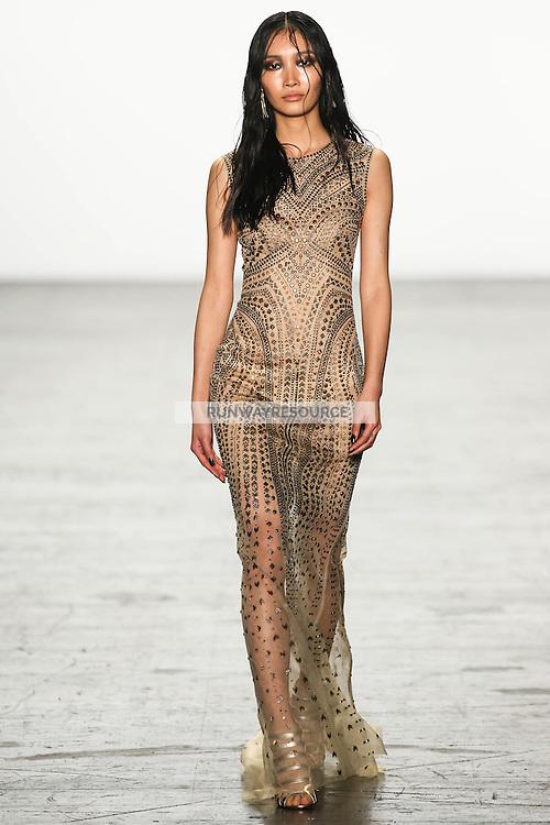 Jisu Hong walks the runway wearing Tadashi Shoji Fall 2016 during New York Fashion Week on February 12, 2016