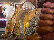 05 JUNE 2014 - YANGON, YANGON REGION, MYANMAR: The reclining Buddha in Chauktatgyi Paya (Pagoda) in Yangon, Myanmar (Rangoon, Burma). Yangon, with a population of over five million, continues to be the country's largest city and the most important commercial center.     PHOTO BY JACK KURTZ