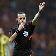 Referee's Cuneyt Cakir (C) during their Turkish superleague soccer derby match Galatasaray between Fenerbahce at the AliSamiYen spor kompleksi TT Arena in Istanbul Turkey on Saturday, 18 october 2014. Photo by Aykut AKICI/TURKPIX