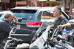 Michael Lichter photographing Scott Jacobs just outside his gallery on Main Street in Deadwood during the annual Sturgis Black Hills Motorcycle Rally. Deadwood, SD, USA. Monday August 7, 2017.  Photography ©2017 Jonathan Pite.