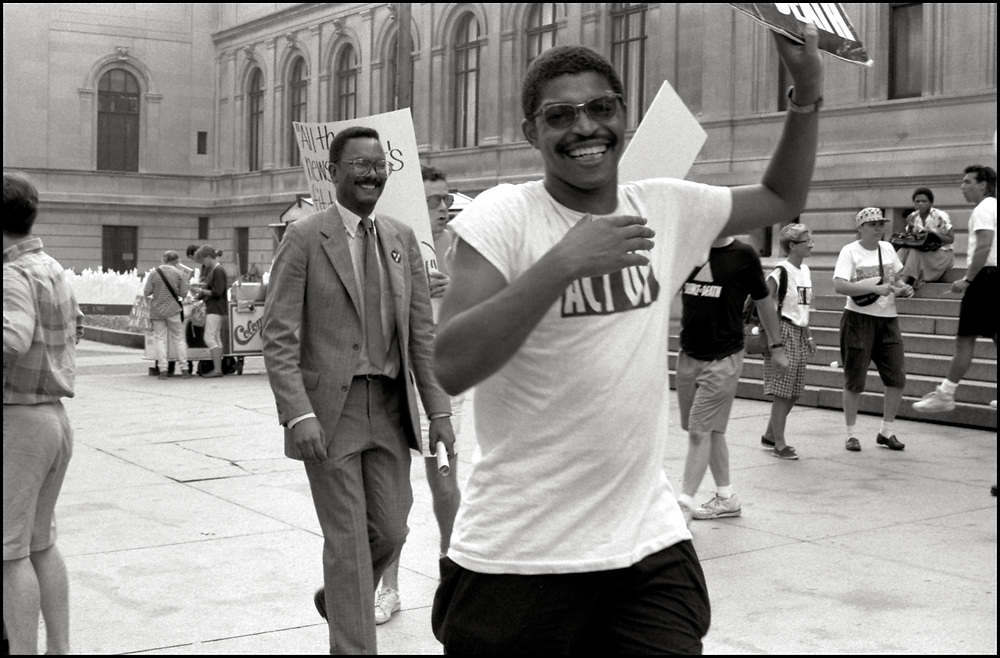 On July 25, 1989, Dan Keith Williams was one of 150 members of ACT UP who demonstrated in front of New York Times publisher Punch Sulzberger's residence at 1010 Fifth Avenue and then marched to West 43rd Street offices of the paper. After threatening a sit-in in Times Square, the protesters were finally allowed to picket on the sidewalk opposite the Times. Several demonstrators held a die-in in front of the building.