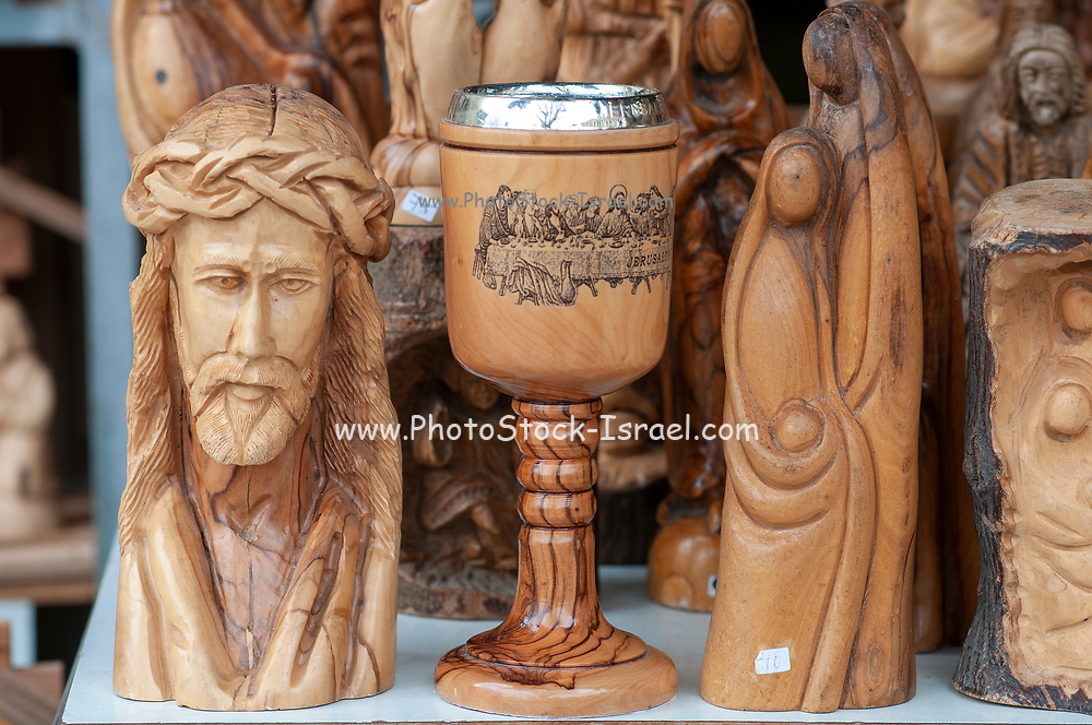 wooden religious figures for sale as Tourist souvenirs at the market in Nazareth, Israel