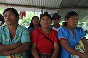 Local Ngäbe women listen during a COCABO members meeting. COCABO: Valle de Agua Arriba, Almirante, Changuinola, Bocas del Toro, Panamá. September 1, 2012.