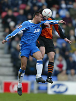 Photo: Chris Brunskill. Wigan Athletic v Ipswich Town. Coca-Cola Championship. 05/03/2005. Lee McCulloch of Wigan goes up for a header with Tommy Miller of Ipswich.