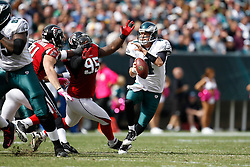 Philadelphia Eagles quarterback Kevin Kolb #4 is pressured by Atlanta Falcons defensive tackle Jonathan Babineaux #95 during the NFL Game between the Philadelphia Eagles and the Atlanta Falcons. The Eagles won 31-17 at Lincoln Financial Field in Philadelphia, Pennsylvania on Sunday October 17th 2010. (Photo By Brian Garfinkel)