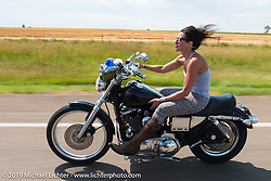 Hilary Goldia of Hill City, SD riding north of Sturgis on highway 79 during the annual Sturgis Black Hills Motorcycle Rally. SD, USA. August 3, 2014.  Photography ©2014 Michael Lichter.
