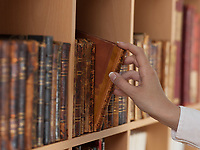 woman hand holding ancient book