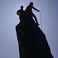 Climbers ascend a pinnacle in California's eastern Sierra Nevada.