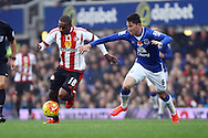 Jermain Defoe of Sunderland and Bryan Oviedo of Everton chase the ball. Barclays Premier League match, Everton v Sunderland at Goodison Park in Liverpool on Sunday 1st November 2015.<br /> pic by Chris Stading, Andrew Orchard sports photography.