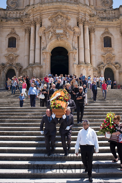 Traditional funeral at the Cathedral of San Giorgio in the city of Modica Alta famous for Baroque architecture, South East Sicily, Italy