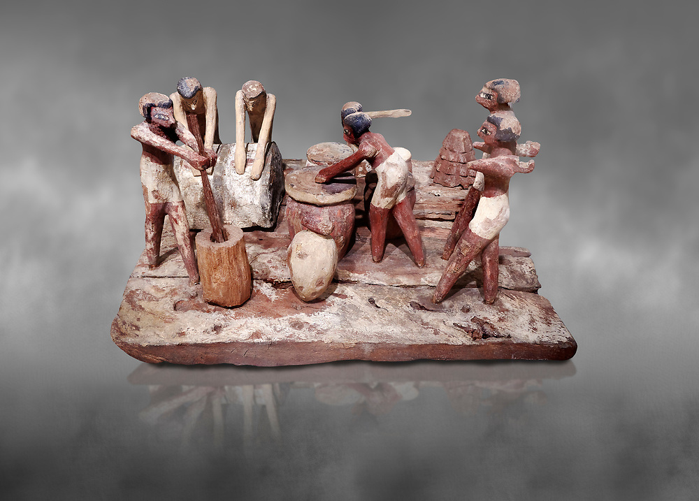 Ancient Egyptian wooden model of bread making, Middle Kingdom, (1939-1875 BC),  Egyptian Museum, Turin.  Grey background. <br /> <br /> Wooden tomb models were an Egyptian funerary custom throughout the Middle Kingdom in which wooden figurines and sets were constructed to be placed in the tombs of Egyptian royalty. These wooden models represented the work of servants, farmers, other skilled craftsman, armies, and religious rituals .<br /> <br /> If you prefer to buy from our ALAMY PHOTO LIBRARY  Collection visit : https://www.alamy.com/portfolio/paul-williams-funkystock/ancient-egyptian-art-artefacts.html  . Type -   Turin   - into the LOWER SEARCH WITHIN GALLERY box. Refine search by adding background colour, subject etc<br /> <br /> Visit our ANCIENT WORLD PHOTO COLLECTIONS for more photos to download or buy as wall art prints https://funkystock.photoshelter.com/gallery-collection/Ancient-World-Art-Antiquities-Historic-Sites-Pictures-Images-of/C00006u26yqSkDOM