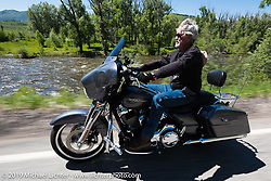 John McClellanof Gillette, WY and member ofthe Gillette HOG Chapter on his Street Glideriding the 20 Mile Road in Steamboat Springs during the Rocky Mountain Regional HOG Rally, Colorado, USA. Saturday June 10, 2017. John is a retired coal miner turned rancher who now tends to over 6,000 acres. Photography ©2017 Michael Lichter.