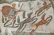 Hunter with dogs chasing a fox from the Room of The Small Hunt, no 25 - Roman mosaics at the Villa Romana del Casale 4th century AD. Sicily, Italy. A UNESCO World Heritage Site. .<br /> <br /> If you prefer to buy from our ALAMY PHOTO LIBRARY  Collection visit : https://www.alamy.com/portfolio/paul-williams-funkystock/villaromanadelcasale.html<br /> Visit our ROMAN MOSAICS PHOTO COLLECTIONS for more photos to buy as buy as wall art prints https://funkystock.photoshelter.com/gallery/Roman-Mosaics-Roman-Mosaic-Pictures-Photos-and-Images-Fotos/G00008dLtP71H_yc/C0000q_tZnliJD08