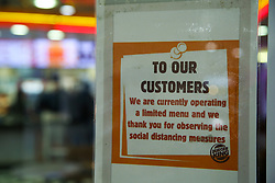 © Licensed to London News Pictures. 17/10/2021. London, UK. 'To Our Customer - We are currently operating a limited menu' sign displayed on a window of Burger King in north London. There are fears that fast food chains could start running out of fry bags and other packaging, due to a shortage of HGV lorry drivers. Photo credit: Dinendra Haria/LNP