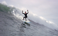 Surfer on big wave in Mendocino County, California