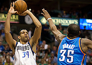 Brandan Wright (34) of the Dallas Mavericks shoots the ball over Kevin Durant (35) of the Oklahoma City Thunder at the American Airlines Center in Dallas on Sunday, March 17, 2013. (Cooper Neill/The Dallas Morning News)