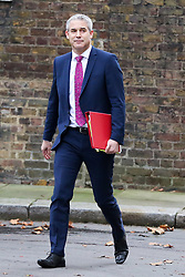 "© Licensed to London News Pictures. 18/12/2018. London, UK. Stephen Barclay- Brexit Secretary arrives in Downing Street for the weekly Cabinet meeting. The Cabinet will discuss the preparations for a ""No Deal"" Brexit. Photo credit: Dinendra Haria/LNP"