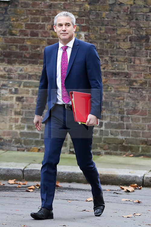 """© Licensed to London News Pictures. 18/12/2018. London, UK. Stephen Barclay- Brexit Secretary arrives in Downing Street for the weekly Cabinet meeting. The Cabinet will discuss the preparations for a """"No Deal"""" Brexit. Photo credit: Dinendra Haria/LNP"""