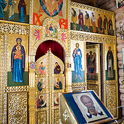 Ornate iconostasis at Trinity Church, a Russian Orthodox church on King George Island in the South Shetland Islands. It is situated on a small rocky hill near Russian Bellingshausen Station research base. Constructed of Siberian cedar and pine with special reinforcements against the harsh weather of Antarctica, Trinity Church was consecrated in 2004 and is the southernmost Eastern Orthodox church in the world.