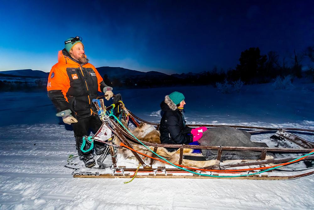 Musher of a dog sled team, Dog sledding, Tromso Wilderness Centre (Tromso Villmarkssenter), Kvaloya Island, near Tromso, Arctic, Northern Norway.