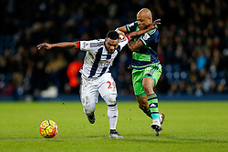 Stephane Sessegnon of West Bromwich Albion is challenged by Andre Ayew of Swansea City - Mandatory byline: Rogan Thomson/JMP - 02/02/2016 - FOOTBALL - The Hawthornes - West Bromwich, England - West Bromwich Albion v Swansea City - Barclays Premier League.