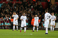 Swansea city players stand dejected as they concede another goal. Premier league match, Swansea city v West Ham United at the Liberty Stadium in Swansea, South Wales on Boxing Day, Monday 26th December 2016.<br /> pic by  Andrew Orchard, Andrew Orchard sports photography.