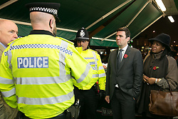 © Licensed to London News Pictures. 03/11/2015. Alum Rock, Birmingham, UK. Shadow Home Secretary ANDY BURNHAM visiting Alum Rock in Birmingham to launch the Labour Policy on Policing. Pictured, from left, JACK DROMEY MP for Erdington, Inspector CHRIS SMITH, Sgt IFTI ALI, ANDY BURNHAM, YVONNE MOSQUITO on the Alum Rock Road. Photo credit : Dave Warren/LNP