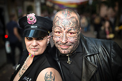 """© Licensed to London News Pictures . 22/08/2014 .  Manchester , UK . Maggie Davies (51 from Collyhurst) and Chris Rowlanson (41 from Blackley) on Canal Street . Manchester Pride """" Big Weekend """" in Manchester's """" Gay Village """" today ( 22nd August 2014 ) . Photo credit : Joel Goodman/LNP"""