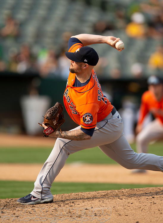 Sep 25, 2021; Oakland, California, USA; Houston Astros pitcher Ryan Pressly (55) delivers a pitch against the Oakland Athletics during the ninth inning at RingCentral Coliseum. Mandatory Credit: D. Ross Cameron-USA TODAY Sports