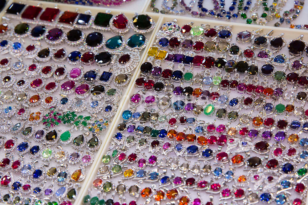 Jewellery and gems on sale on a market stall in Siem Reap Art Centre Night Market in Siem Reap, Cambodia, Asia. This market was opened in 2012.