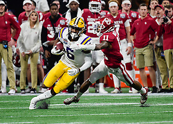 LSU Tigers wide receiver Terrace Marshall Jr. (6) is grabbed from behind by Oklahoma Sooners cornerback Parnell Motley (11) during the first half against  in the 2019 College Football Playoff Semifinal at the Chick-fil-A Peach Bowl on Saturday, Dec. 28, in Atlanta. (Vasha Hunt via Abell Images for the Chick-fil-A Peach Bowl)