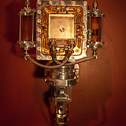 """""""Untouchable"""" 4""""x5"""" camera mounted on its exhibition wall mount. Front view."""