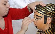 A boy of 10 dresses up as a Pharaoh