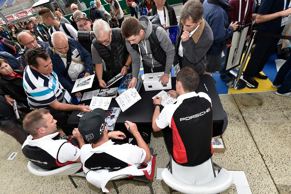 #94 Porsche GT Team Porsche 911 RSR: Romain Dumas, Timo Bernhard, Sven Müller autograph session<br /> Tuesday 12 June 2018<br /> 24 Hours of Le Mans<br /> Verizon IndyCar Series<br /> Circuit de la Sarthe  FR<br /> World Copyright: Scott R LePage<br /> LAT Images