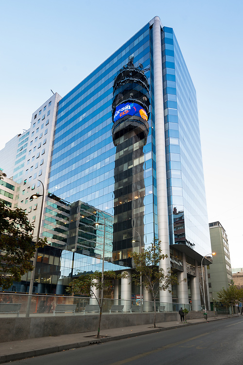 Santiago de Chile, Region Metropolitana, Chile, South America - The iconic Entel tower reflected on a modern office building in downtown Santiago.