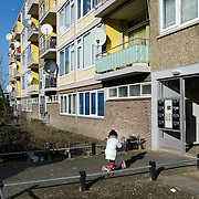"Nederland Utrecht 31 januari 2009 20090131 Foto: David Rozing ..Serie vogelaarwijk Kanaleneiland .Reportage documentary on deprived area / projects "" Kanaleneiland "" This area is on a list with projects which need help of the government because of degradation in the area etc..Meisje speelt buiten op step voor appartementen complex.Girl plays outside..islam, islamic, project, suburb, suburbian, problem. Neighboorhood, neighboorhoods, district, city, problems, multicultural, immigrant, immigrants, cultural diversity, daily life.satelietschotel,satelietschotels, antenne,satelliet,sateliet,satelietontvanger,satellietontvanger,schotels,antenneschotel,antenneschotels,schotelantenne,schotelantennes,tv,ontvangst,communicatie,electronica,tv ontvangst,televisie ontvangst,Foto: David Rozing"